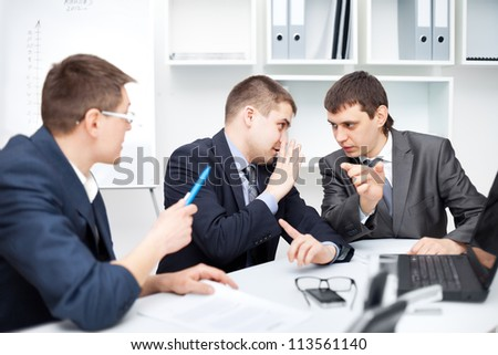 Team of young business men working together at office, discuss the case - stock photo