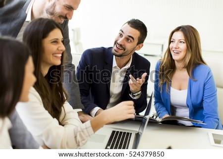 Team of young motivated successful people are on the business meeting