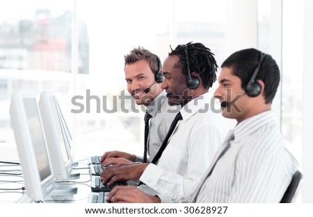 Team of Young People working in a call centre - stock photo