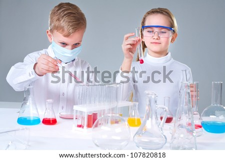 Team of young prodigies conducting scientific experiments - stock photo