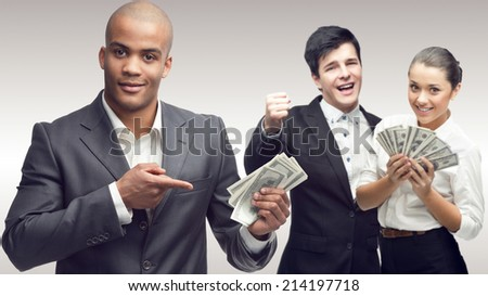 team of young successful business people standing over gray background - stock photo