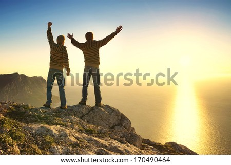 Team on the mountain top. Sport and active life concept - stock photo