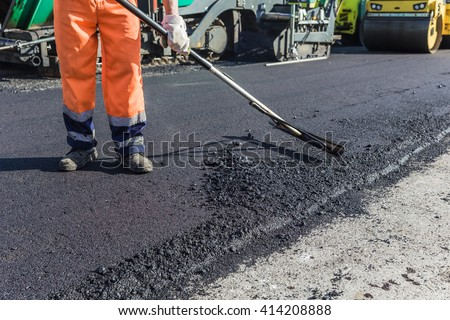 Team pave the roadway - stock photo