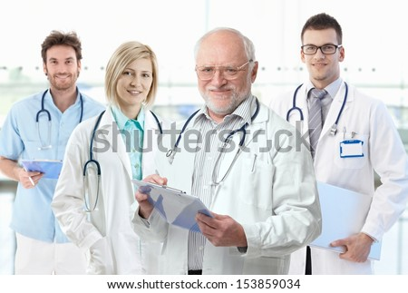 Team photo of healthcare workers, professor with medical students. - stock photo