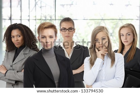 Team portrait of confident businesswomen at office.
