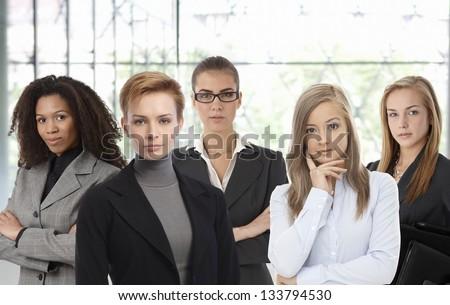 Team portrait of confident businesswomen at office. - stock photo