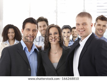 Team portrait of group of happy successful business people smiling. - stock photo