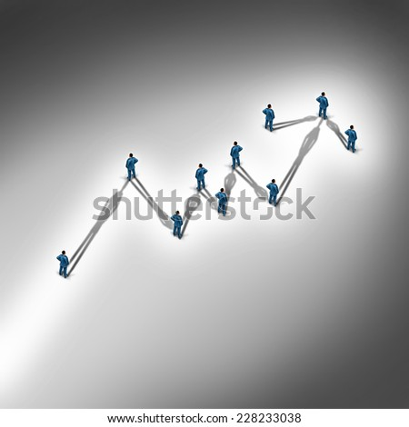 Team profit as a financial business concept with a group of people connected together with cast shadows in the shape of a stock market chart with an upward arrow as a metaphor for investment success. - stock photo