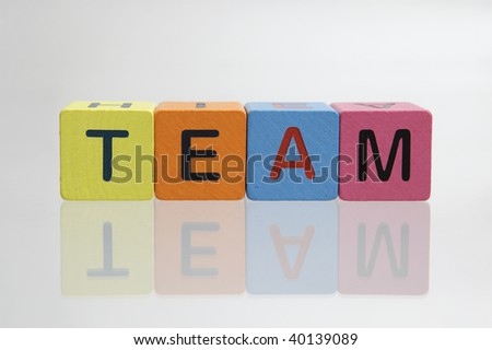 Team spell out in block letters