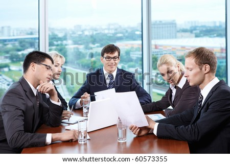 Team staff leads a discussion in the office - stock photo