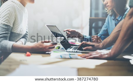 Team succes concept. Businessmans crew working with new startup project. Generic design notebook on wood table.  Analyze plans hands, keyboard. Blurred background, film effect - stock photo