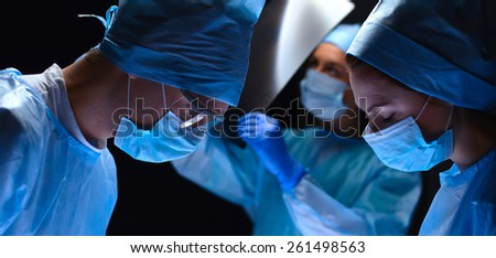 Team surgeon at work in operating. Hospital.