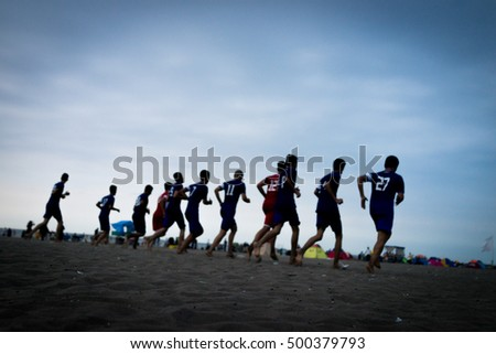 Team training of young boys on the sunset beach