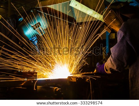 Team Welder movement Industrial automotive part in factory - stock photo