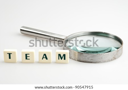 Team word and magnifying glass