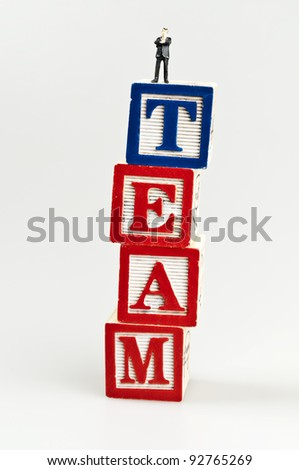 Team word and toy business man - stock photo