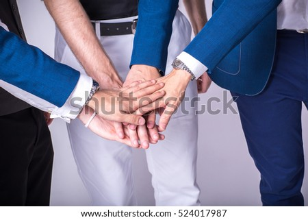 Team work business ideas concept. Business people with suit joining hands.