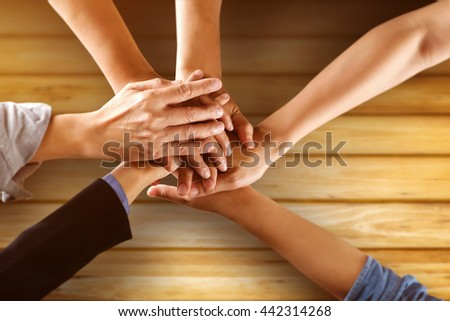 Team work business team showing unity with their hands together. - stock photo