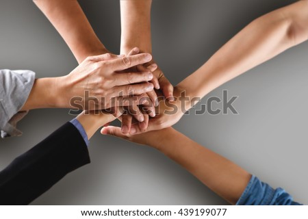 Team work business team showing unity with their hands together with clipping path.