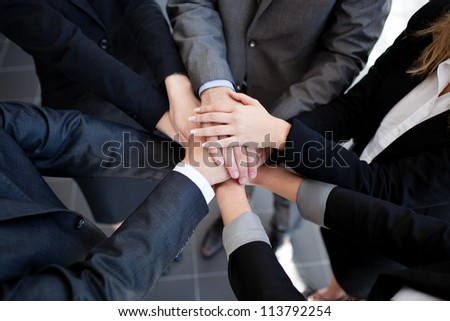 Team work concept. Business people joining hands. - stock photo