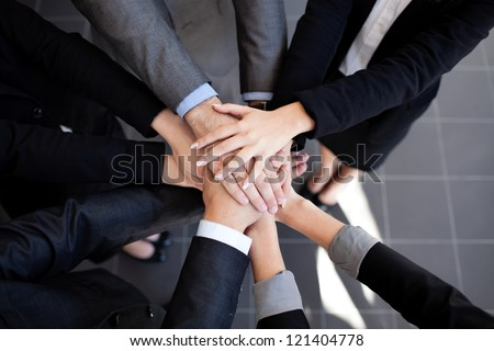 Team work concept. Business people joining hands.