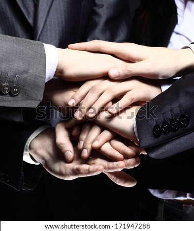 Team work concept. Business people joining hands - stock photo