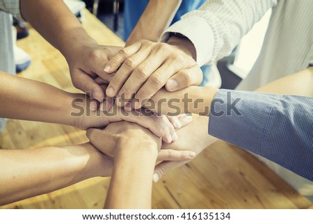 Team work concept.Business team standing hands together in the office.Business people joining hands.Group of Diverse Multiethnic People Teamwork Concept.selective focus,vintage color