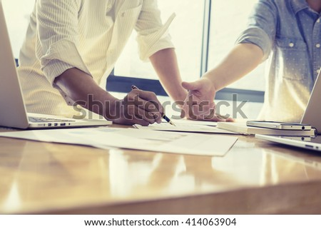 Team work concept,team meeting,Business people using laptop at office, business crew working with new startup project laptop. Project managers meeting. Analyze plans.selective focus,vintage color - stock photo