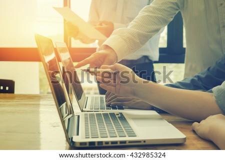 Team work concept,team meeting,man and woman working in the office. collaborative teamwork. Project managers meeting.business crew working with new startup.Analyze plans.selective focus,vintage color  - stock photo