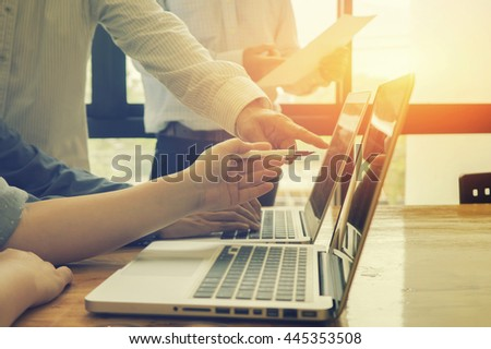 Team work concept,team meeting,man and woman working in the office. collaborative teamwork.Project managers meeting.business crew working with new startup. Analyze plans.selective focus,vintage color  - stock photo