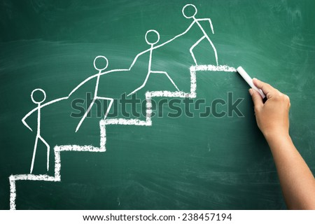 Team work for success, handwriting with chalk on blackboard - stock photo