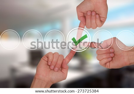 Team work hands touching check mark on virtual screen. Business technology concept. Isolated on office. Stock Image - stock photo