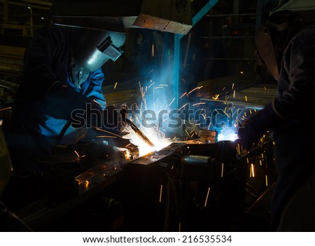 Team work is welding skills up. (Manufacturing of car). - stock photo
