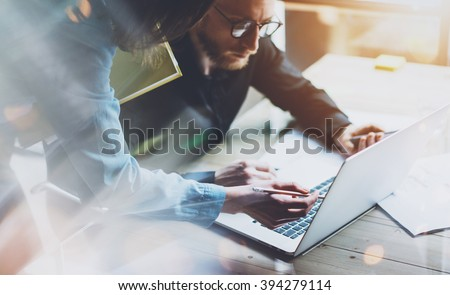 Team work process. Photo young business crew working with new startup project laptop. Project managers meeting. Analyze plans, papers. Blurred background, film effect - stock photo