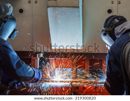 Team work welder steel in Industrial - stock photo