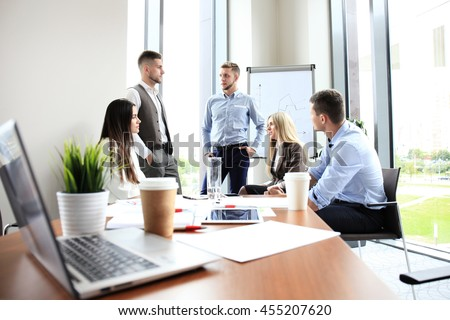 Team young professionals having casual discussion in office. Executives having friendly discussion during break. - stock photo