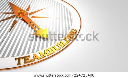 Teambuilding - Golden Compass Needle on a White Field Pointing. - stock photo