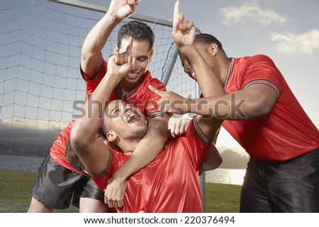 Teammates gesturing number one - stock photo