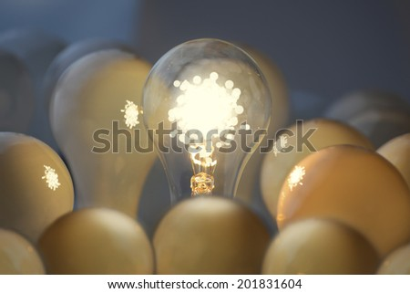 Teamwork and communication business concepts. Idea symbol, light bulb. - stock photo