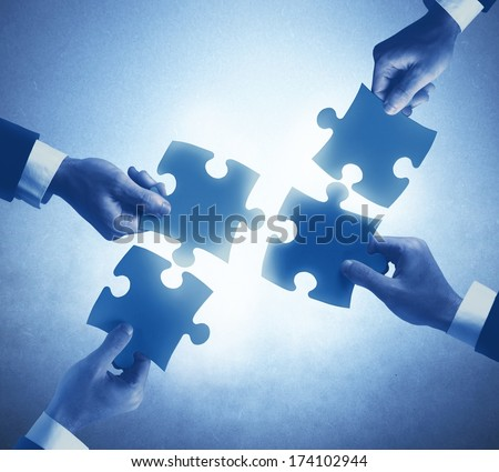 Teamwork and integration concept of a businesspeople - stock photo
