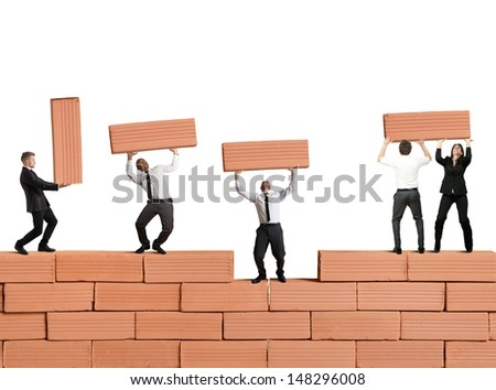 Teamwork builds a new business with bricks - stock photo
