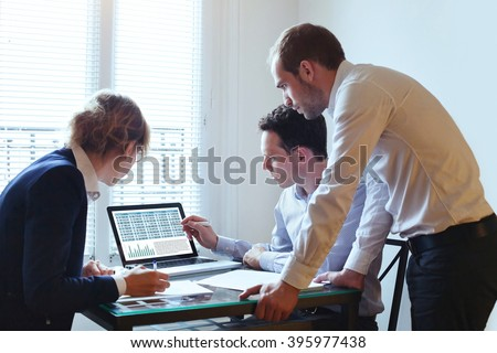 teamwork, business meeting, team working on financial plan - stock photo