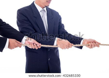 Teamwork businessman team ,team pulling rope for show power of group concept.