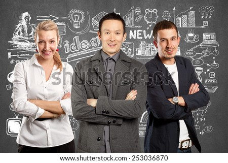 Teamwork concept. Asian man in suit, looking on camera, with folded hands - stock photo