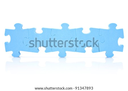 teamwork concept. five puzzle pieces connected in a row - stock photo