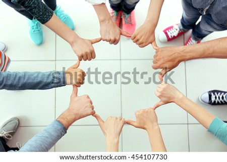 Teamwork concept. United hands, top view - stock photo
