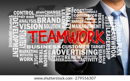 teamwork concept with business word cloud hand drawn by businessman