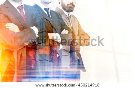Teamwork concept with businesspeople crossing arms on city background with sunlight. Double exposure - stock photo
