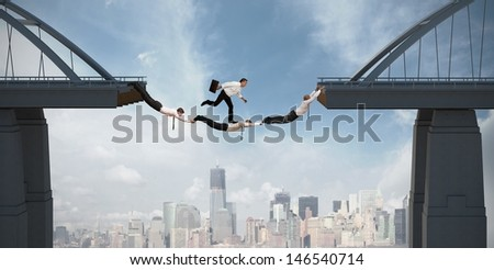 Teamwork concept with running businessman over the bridge - stock photo