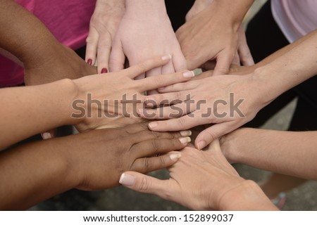 Teamwork: group putting hands together